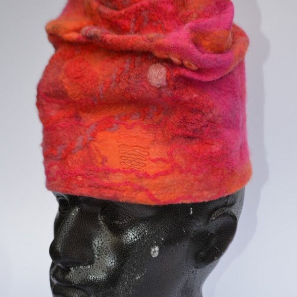Red hat in felt on model by Pearl Taylor