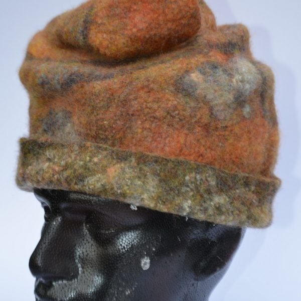 Rust-coloured felt hat on model by Pearl Taylor